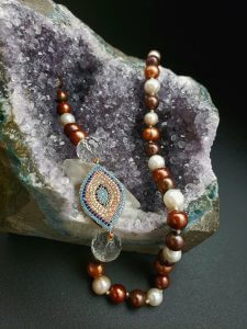 Brown and White Pearl and Clear Quartz with Copper Plated Cubic Zirconia Festoon