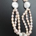 Freshwater-Pearls-with-Mother-of-Pearl-Nautilus-Pendant-445x1024